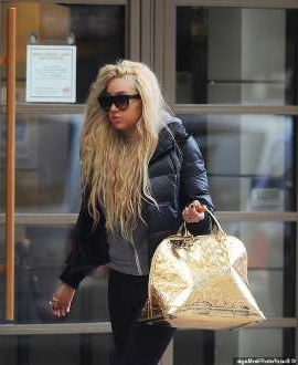 a woman standing in front of a store: Amanda Bynes has left her sober living facility amid a legal battle over the actress' conservatorship, The Blast reported on Thursday. Seen here in 2013