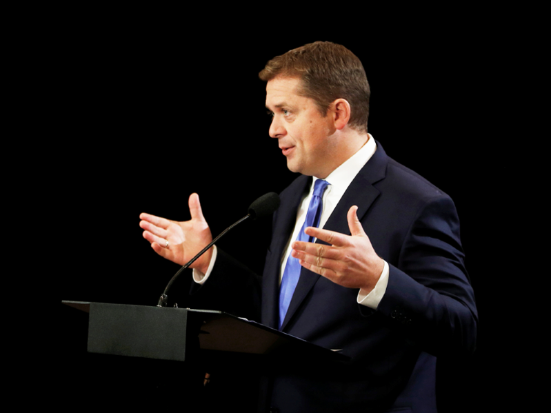 Andrew Scheer wearing a suit and tie: Federal Conservative leader Andrew Scheer has faced attacks for years by political opponents and even members of his own party because of his social conservatism.