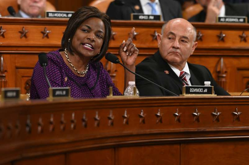Lou Correa, Val Demings sitting at a table: Rep. Val Demings, D-Fla., gives her opening statement as the House Judiciary Committee meets to markup Articles of Impeachment against President Donald Trump.