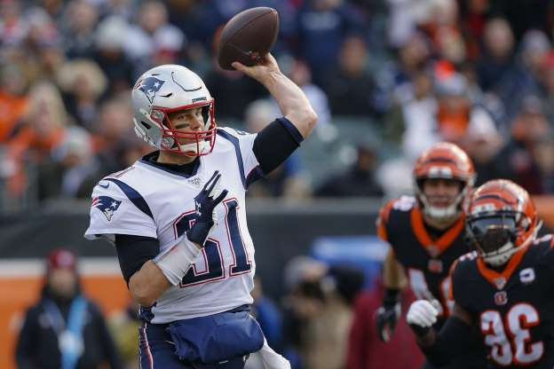 New England Patriots quarterback Tom Brady (12) passes in the first half of an NFL football game against the New England Patriots, Sunday, Dec. 15, 2019, in Cincinnati. (AP Photo/Gary Landers)