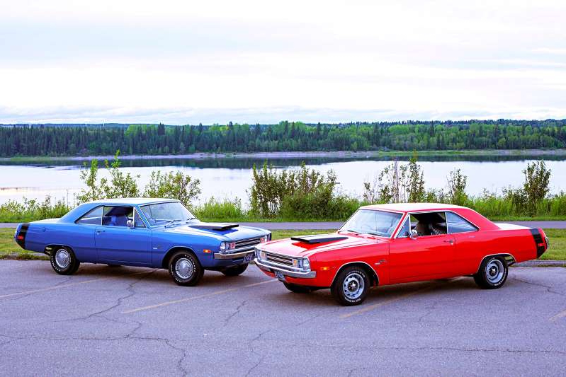 a car parked in a parking lot next to a body of water: 001-guinand-fitzpatrick-1972-dodge-dart-swinger-340-parked