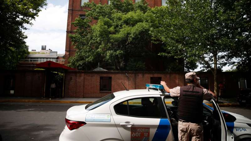a police car parked in a parking lot: Police at the scene of the incident in the Argentinian capital