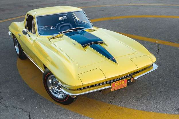 a yellow car parked on the side of a road: It's a beaut. Corvette Mike