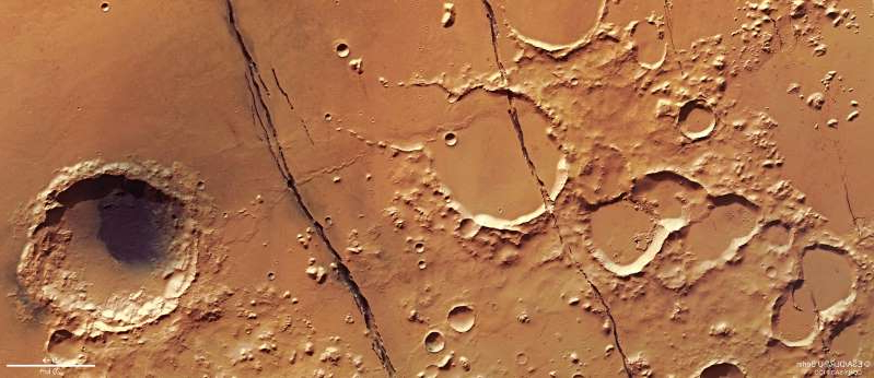 Several deep fractures cut across Mars's cratered surface in this image taken in January 2018 by the European Space Agency's Mars Express orbiter. These gashes are part of the Cerberus Fossae system near the Martian equator.