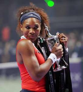 Serena Williams holding a microphone