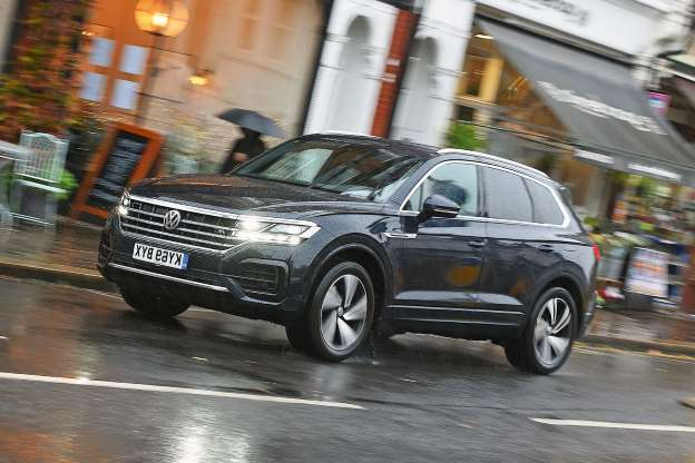 a car parked on a rainy day: Volkswagen Touareg 2019 long-term review