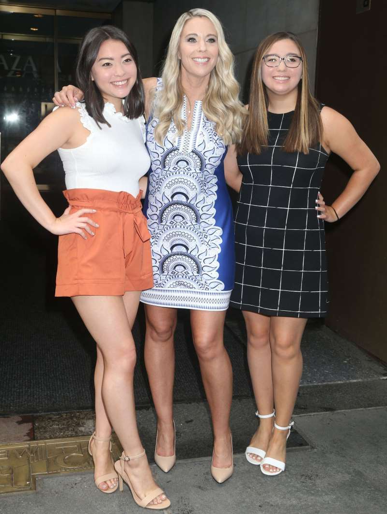 a person standing in front of Cara Gosselin, Kate Gosselin posing for the camera: Cara Gosselin, Kate Gosselin and Mady Gosselin appear at