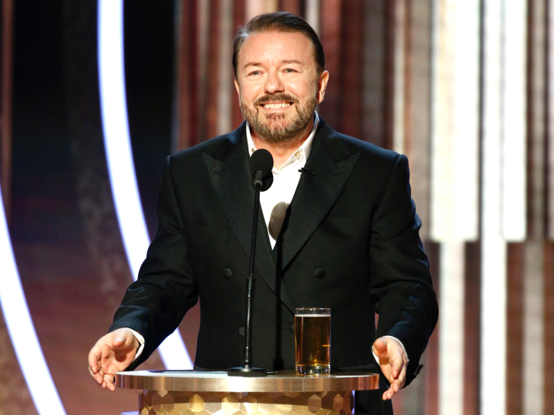 Ricky Gervais wearing a suit and tie