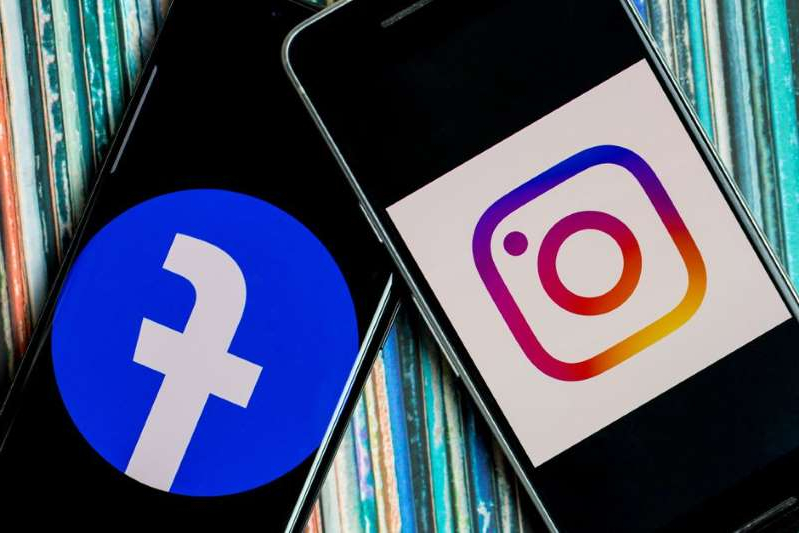 a close up of a sign: Facebook's social media empire includes popular photo sharing app Instagram. Angela Lang/CNET
