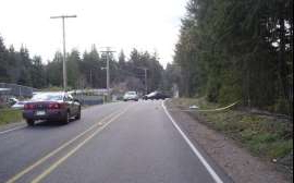 a car is lined up on the side of a road: The scene during the afternoon of April 5, 2006, in the 3300 block of SE Bielmeier Road, South Kitsap, when a deceased infant girl was discovered abandoned along the roadside.
