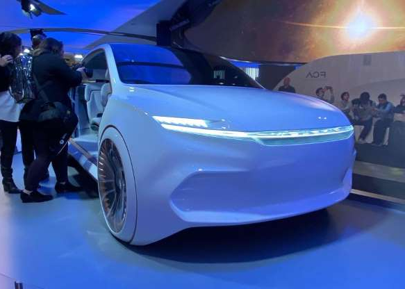 a person in a blue car: This is Fiat Chrysler's Airflow Vision concept.