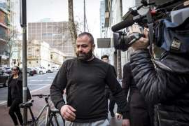 a person riding a bicycle on a city street: Underworld figure Nabil Maghnie leaves court last July.