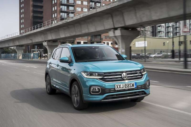 a car parked on the side of a building: Volkswagen T-Cross gets new range-topping 1.5-litre petrol engine