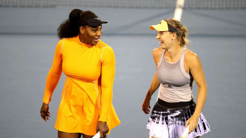 Serena Williams with a racket on a court: Serena Williams (R) and Caroline Wozniacki (L)