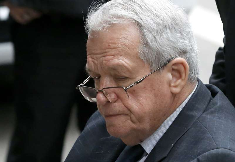 a man wearing a suit and tie: Former house speaker Dennis Hastert departs the federal courthouse on  April 27, 2016, in Chicago, after his sentencing on federal banking charges which he pled guilty to last year.