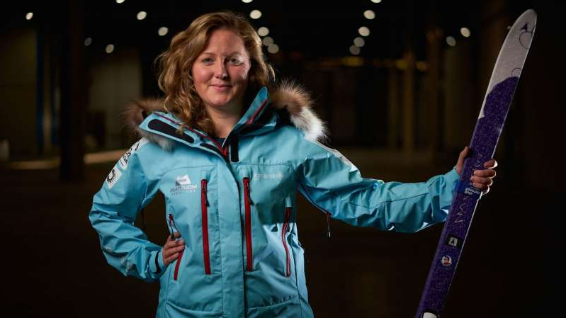 a person wearing a blue jacket: Mollie Hughes battled through snow storms and temperatures of -45C to reach the South Pole