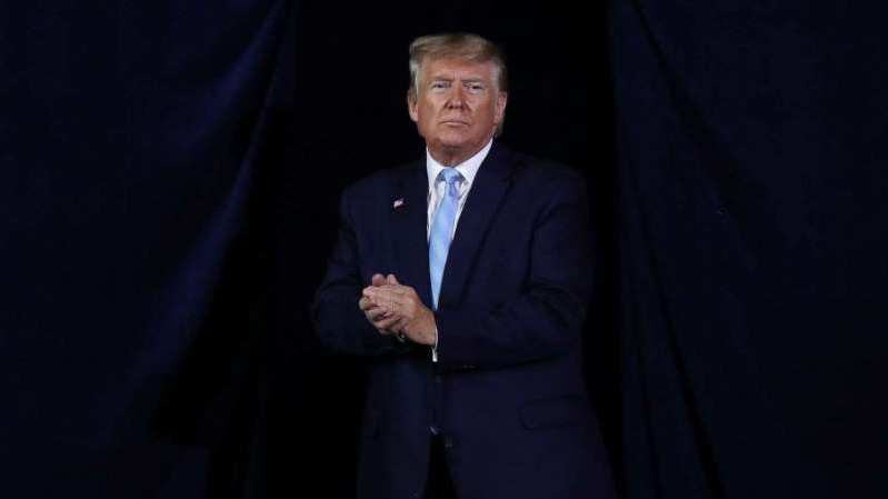 Donald Trump wearing a suit and tie: President Donald Trump exits after holding an 'Evangelicals for Trump' campaign event held at the King Jesus International Ministry, Jan. 3, 2020, in Miami.