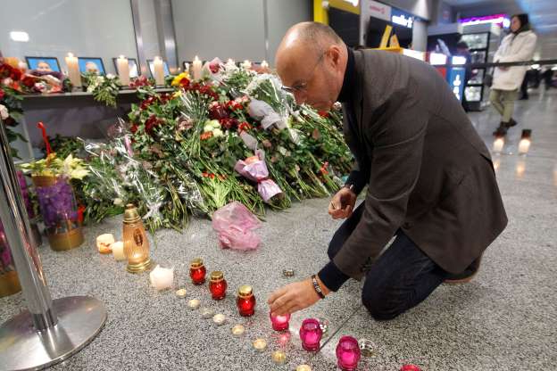Slide 1 of 45: Ukraine International Airlines (UIA) President Yevhenii Dykhne light candles to a makeshift memorial for the crew members of the Ukrainian Boeing 737-800 plane that crashed in Iran, at the Boryspil International Airport, not so far from Kyiv, Ukraine , on 11 January, 2020.  (Photo by STR/NurPhoto via Getty Images)