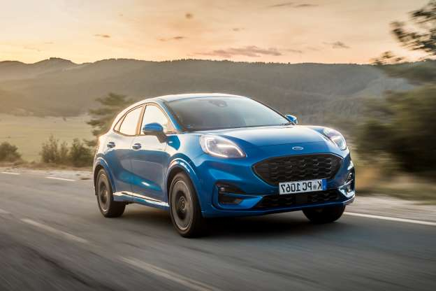 a car driving on a road: Ford Puma 1.0 Ecoboost 155 ST-Line X 2020 review