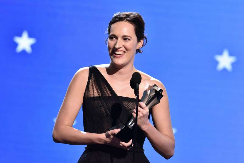 Phoebe Waller-Bridge standing posing for the camera: Photo by Rob Latour/Shutterstock
