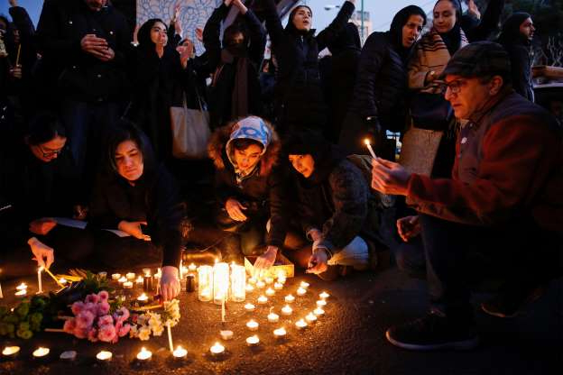 Slide 1 of 49: Iranians light candles for the victims of Ukraine International Airlines Boeing 737 during a gathering in front of the Amirkabir University in the capital Tehran, on January 11, 2020.
