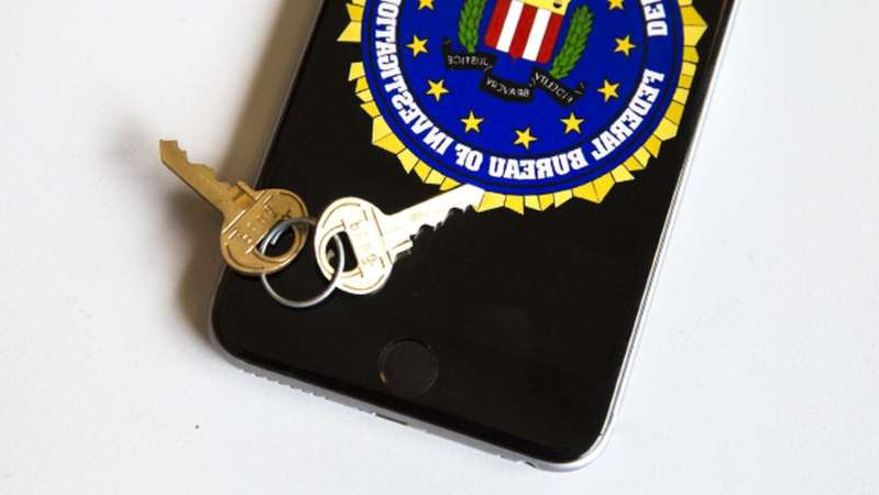 a close up of a cell phone: Attorney General William Barr says the FBI has received court authorization to search two iPhones. James Martin/CNET