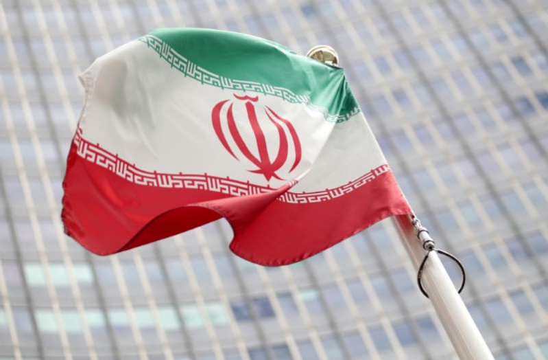 a close up of a red bag: FILE PHOTO: The Iranian flag flutters in front the International Atomic Energy Agency headquarters in Vienna
