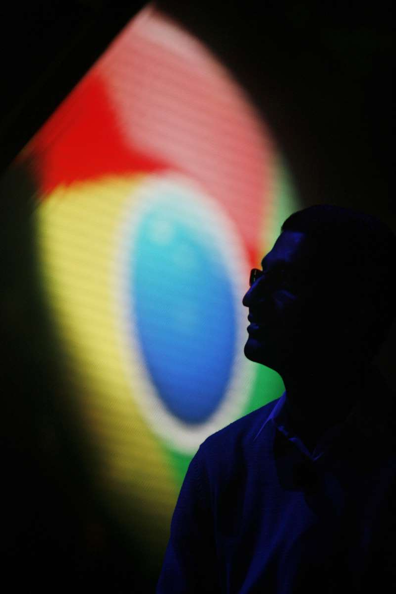 a man in a dark room: Google optimizes Chrome OS for tablet use.