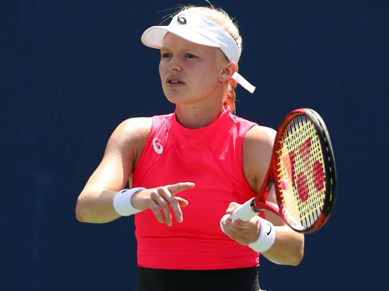 a person holding a racket: Harriet Dart is through to the second round of qualifying for the Australian Open