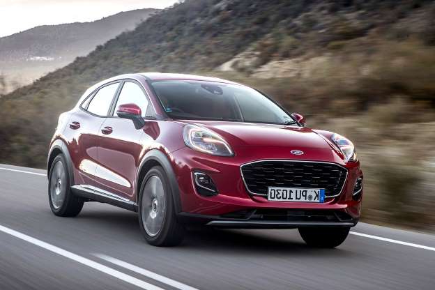a red car driving on a road: Ford Puma 1.0T 125 Titanium 2020 review