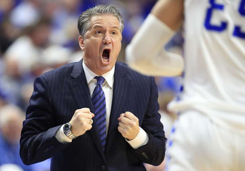 John Calipari wearing a suit and tie: John Calipari, the head coach of the Kentucky Wildcats, gives instructions to his team against the Alabama Crimson Tide at Rupp Arena on Saturday, Jan. 11, 2020 in Lexington, Ky.