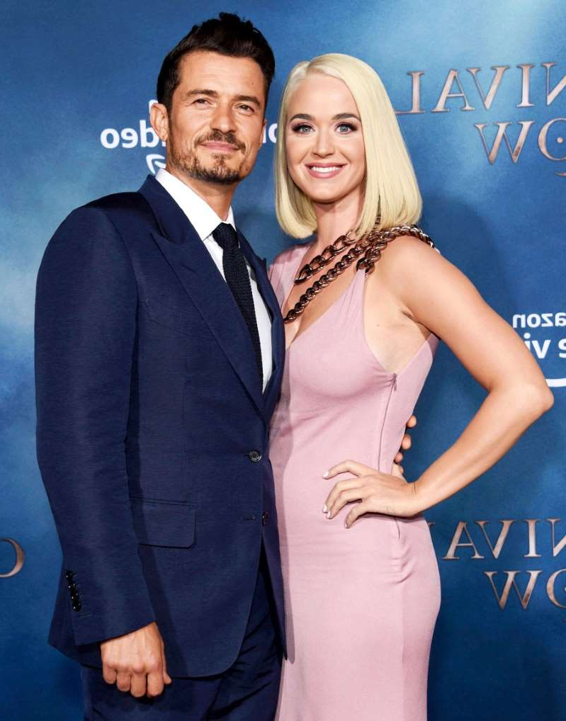 Katy Perry, Orlando Bloom posing for a photo: Katy Perry and Orlando Bloom at the TV premiere of 'Carnival Row' on August 21, 2019 in Los Angeles, California.
