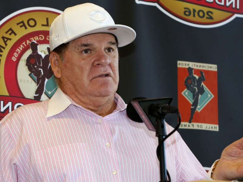 Pete Rose wearing a hat