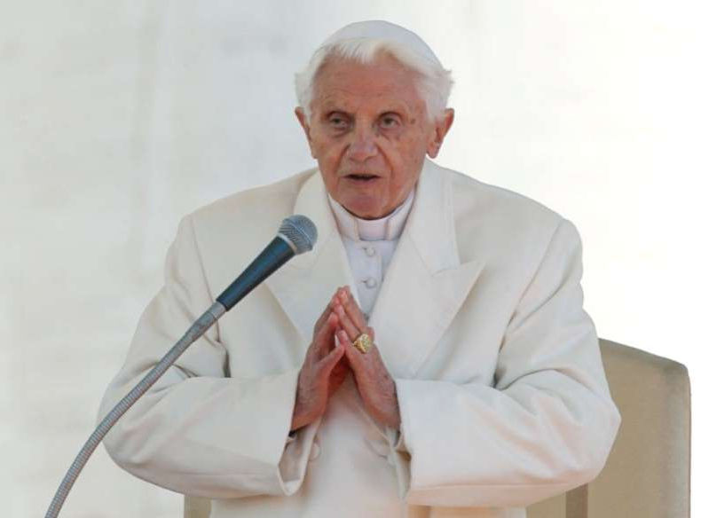 Pope Benedict XVI wearing a suit and tie: FILE PHOTO: Pope Benedict XVI finishes his last general audience in St Peter's Square at the Vatican