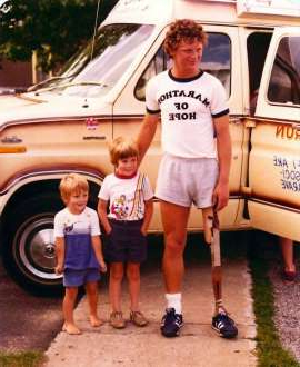 a group of people standing in front of a car posing for the camera: 39 years after Terry Fox's iconic run, Jade Gritzfeld said her work and the Terry Fox Foundation's work will not be over under the disease is cured.