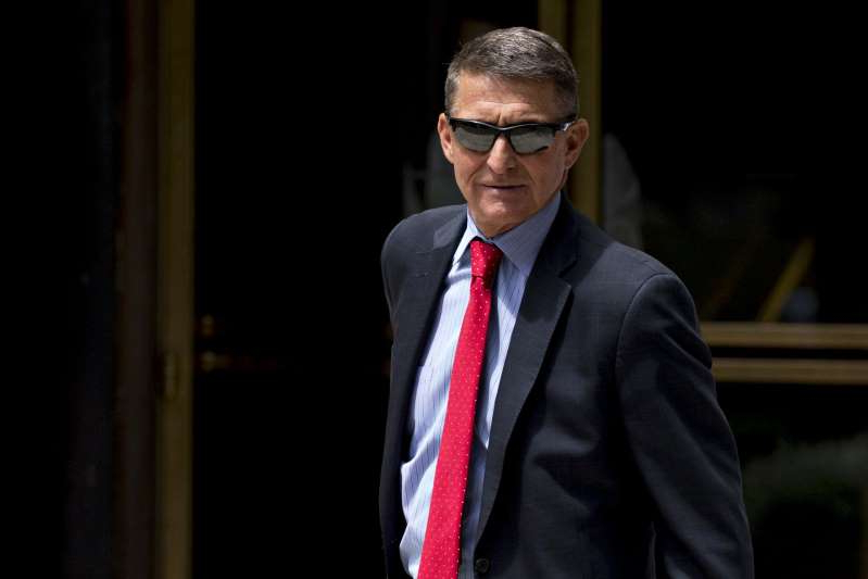 a man wearing a suit and tie: Former National Security Advisor Michael Flynn Status Conference Hearing
