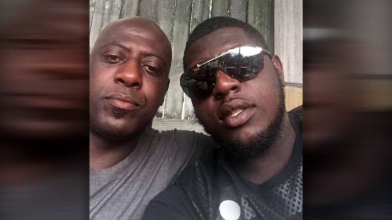 a man wearing glasses and smiling at the camera: The victims of a double shooting in Framingham: 24-year-old James Wade, left, and his 45-year-old father,