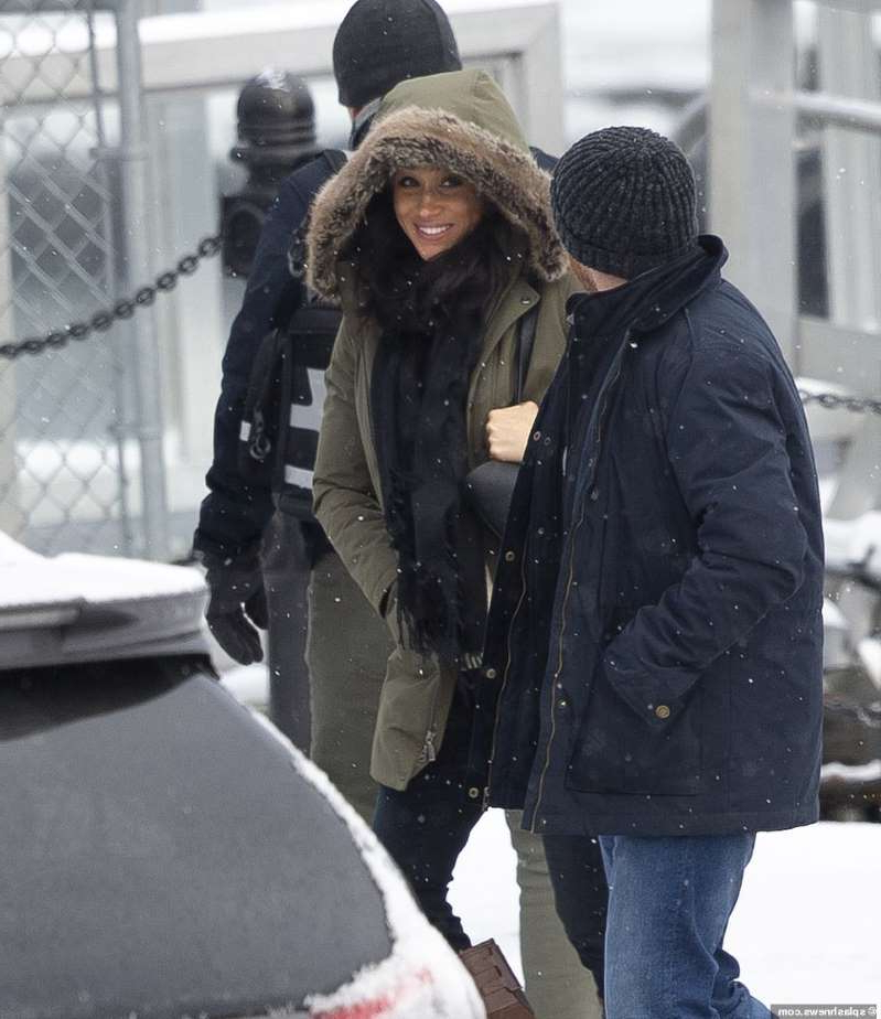 a person standing in front of a building: A smiling Meghan Markle was spotted Tuesday leaving the $14million Vancouver Island home where she and Prince Harry stayed over the holidays with Archie. She has been staying in the mansion since last week, but Archie was nowhere to be seen Tuesday