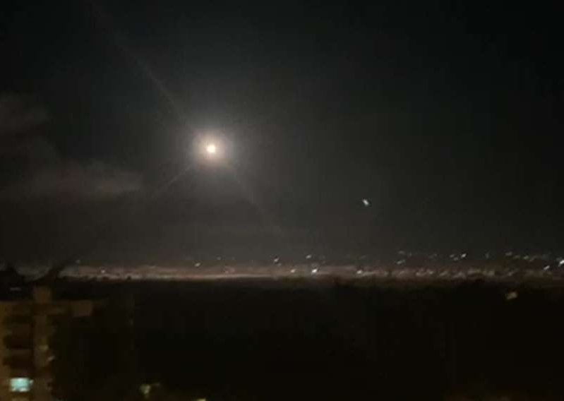 a sky view looking up at night: An image grab shows on November 20, 2019 reportedly shows Syrian air defense batteries responding to Israeli missiles targeting the southern outskirts of Damascus. - The Israeli military said at the time that it targeted Iranian Quds Force and Syrian military targets