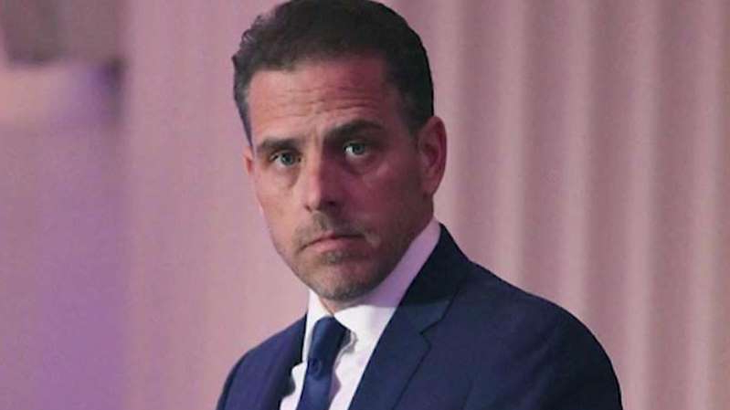 Hunter Biden wearing a suit and tie
