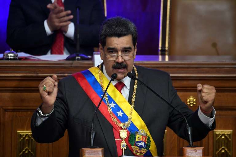 Nicolas Maduro wearing a suit and tie: Venezuelan President Nicolas Maduro gestures during an address to the Constituent Assembly in Caracas
