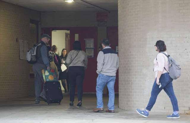 Slide 1 of 21: Classes are canceld at Bellaire High School, but teachers and staff return to school after a student was shot on campus and later died at the hospital on Wednesday, Jan. 15, 2020, in Bellaire.