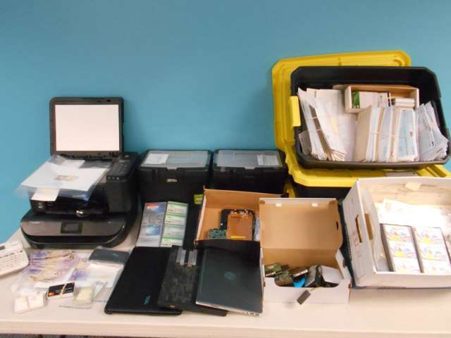 a group of items on a table:  Michael Benjamin Stott of Surrey has been charged with three counts of break and enter, two counts of possession of break-in instruments, two counts of disguising face with intent to commit a crime and once count of theft of mail.