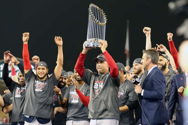 Eduardo Rodríguez et al. standing in front of a crowd posing for the camera: The Astros and Red Sox World Series trophies aren't coming back, and they definitely aren't going to the Dodgers. (Photo by Rob Leiter/MLB via Getty Images)
