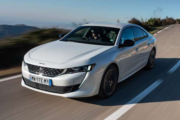 a car parked in a parking lot: Peugeot 508 Hybrid 225 GT 2020 review