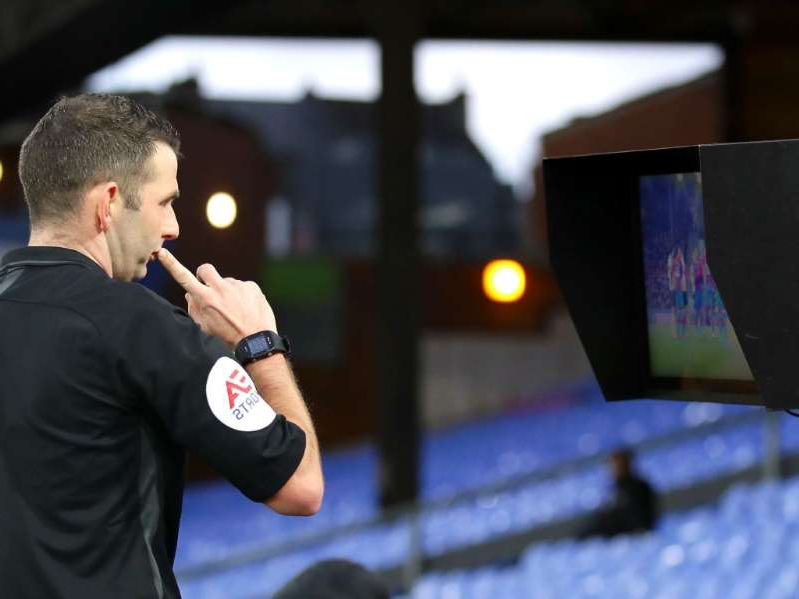 a man wearing a suit and tie: Michael Oliver used a monitor in the FA Cup tie between Crystal Palace and Derby this month