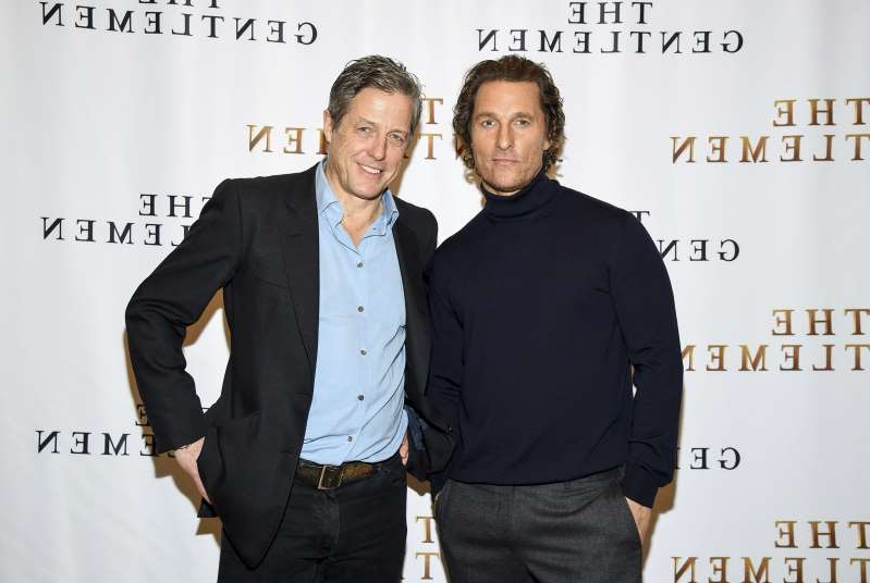 Matthew McConaughey, Hugh Grant are posing for a picture: Actors Matthew McConaughey, left, and Hugh Grant pose together during photo call for the film