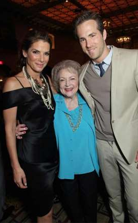 Ryan Reynolds, Betty White, Sandra Bullock posing for the camera: Eric Charbonneau/Shutterstock