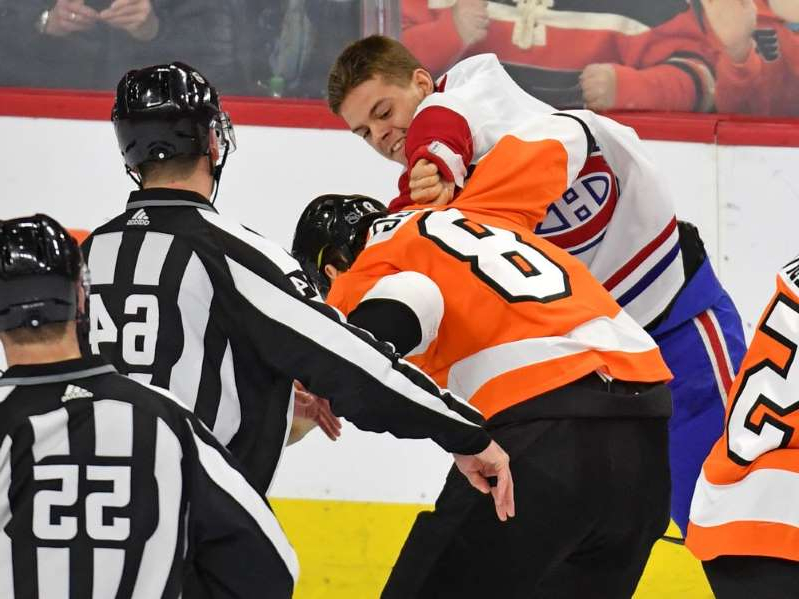 a group of people in uniform: The Canadiens' Jesperi Kotkaniemi and the Flyers' Robert Hagg fight during the third period at the Wells Fargo Center in Philadelphia on Jan. 16, 2020.