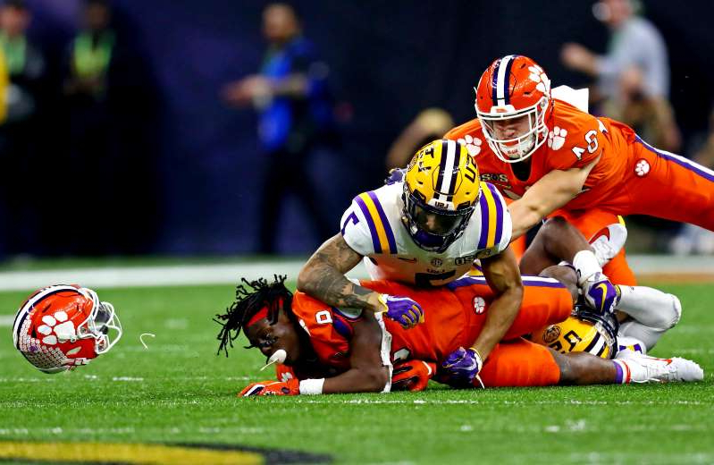 Jan 13, 2020; New Orleans, Louisiana, USA; LSU Tigers safety Grant Delpit (7) tackles Clemson Tigers running back Travis Etienne (9) during the second quarter in the College Football Playoff national championship game at Mercedes-Benz Superdome. Mandatory Credit: Matthew Emmons-USA TODAY Sports     TPX IMAGES OF THE DAY